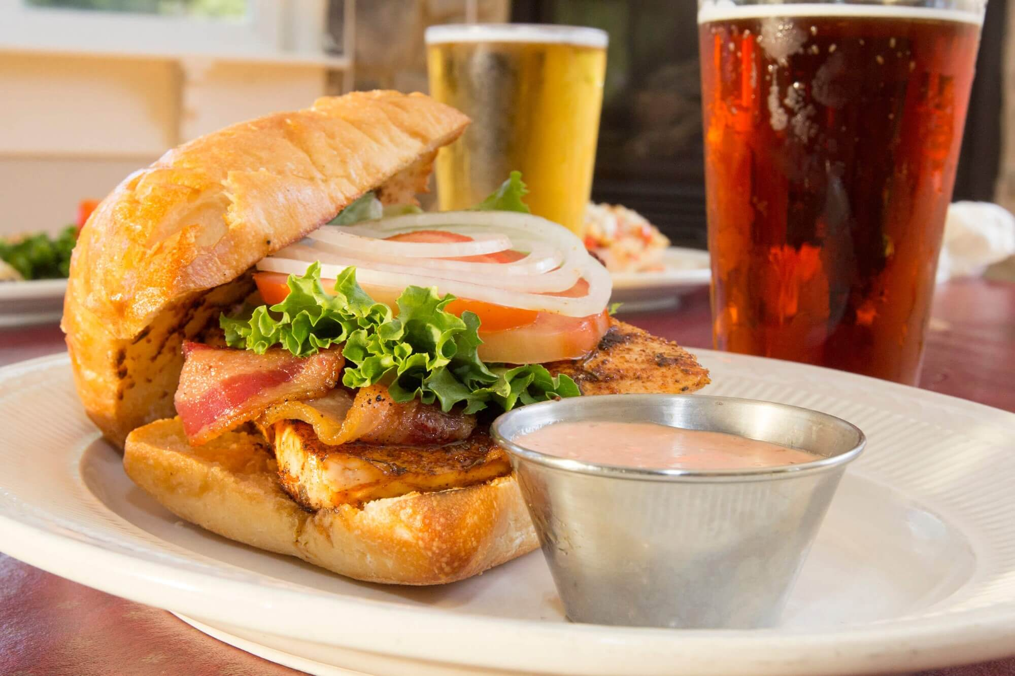 Adam's Taphouse and Grille Prince Frederick fillet bacon on ciabatta sauce and pints of beer